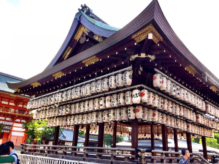 Walk down Shijo Street, cross the river and you'll end up at Yasaka Shrine. The large read Tori gate at the dead end of the street is hard to miss.