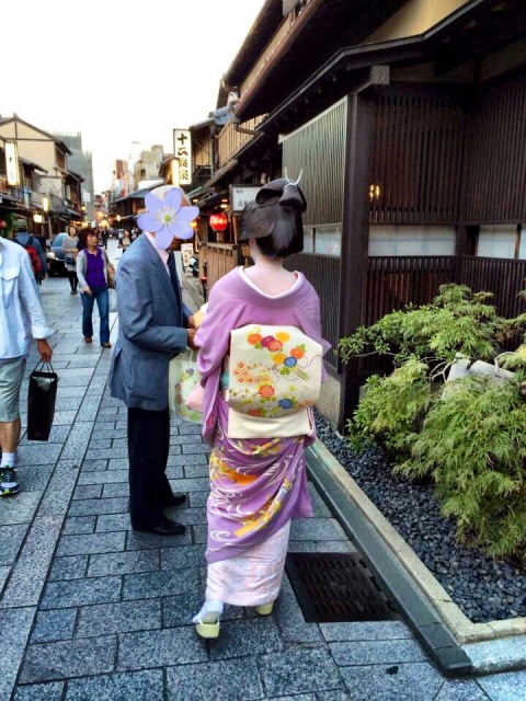 This woman is a Geiko. Her obi is short and hairstyle is more subdued. When taking a photo of a Maiko or Geiko, please don't stop them or get in their way. They're on their way to work. Also, it's considered bad form to take a picture of the client if she is with one. Whoops!