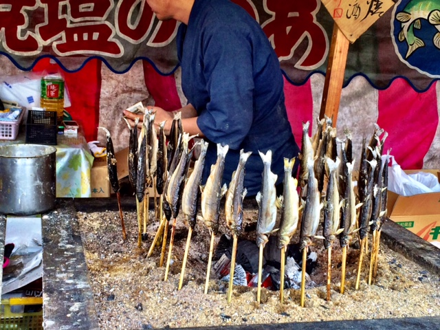 If you're lucky enough to be there during one of the festivals, make sure to sample food from the vendors! Japanese festival food is unbelievably delicious. This is one of my favorite - ayu. Little fishes grilled around a charcoal fire.